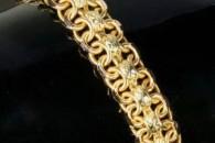 Фотоогляд жіночих золотих браслетів з дорогоцінними каменями і без них