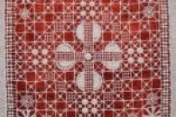 Витончена ажурна вишивка на серветці та інших виробах