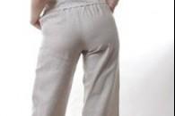 Складки на брюках під сідницями. Як вшити брюки.