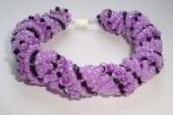 Уроки плетіння різних браслетів з бісеру і намистин